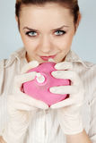 Girl holds the enema Stock Image