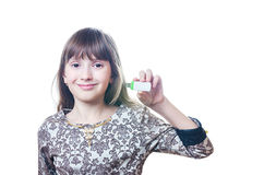 The girl holds a flash card in hand Stock Images