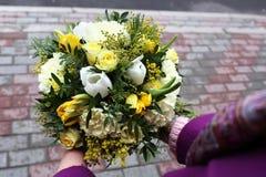 Girl holds flowers Stock Photo