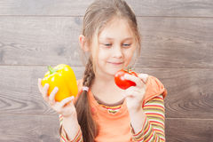 Girl holds fresh vegetables Stock Image