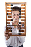 Girl holds in front of abacus Royalty Free Stock Image
