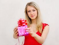 The girl holds a gift Stock Photos