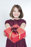 The girl holds a gift. Royalty Free Stock Photos