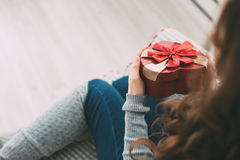 Girl holds a gift for the holiday. Valentine / birthday / new year. Royalty Free Stock Image