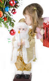 Girl holds gift and kisses Santa Royalty Free Stock Photo