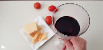 A girl holds glass of red vine stock image