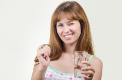 The girl holds a glass with water in hand Royalty Free Stock Photography