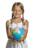 The girl holds the globe Stock Images