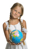 The girl holds the globe collected from puzzle Royalty Free Stock Images