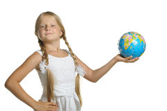 Girl holds the globe collected from puzzle Stock Photos