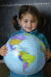 Girl holds a globe Royalty Free Stock Image