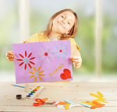 Girl holds greeting card Royalty Free Stock Image