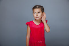 Girl holds the hand of a child listening to ear on Royalty Free Stock Image