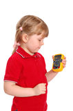 The girl holds in a hand a digital multimeter Stock Image