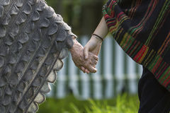 The girl holds the hand of his grandmother. Close up of hands Stock Image