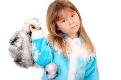 Girl holds in a hand a winter fur cap Royalty Free Stock Photo
