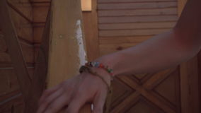 Girl Holds on the handrail and goes down the stairs stock video