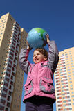 Girl holds in hands balloon in form of globe Royalty Free Stock Photo