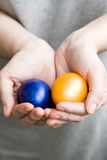 The girl holds in hands colored Easter eggs Royalty Free Stock Photo