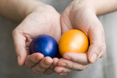 The girl holds in hands colored Easter eggs Stock Images