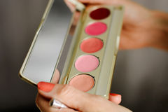 Girl holds in the hands of cosmetics Royalty Free Stock Images