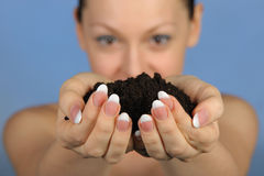 The girl holds in hands soil Royalty Free Stock Photography