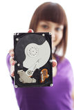 A girl holds a hard disk. On a white background Stock Images