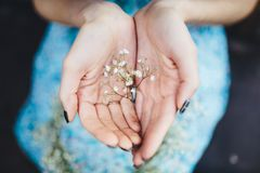 Girl holds head wreath in hands Royalty Free Stock Photography
