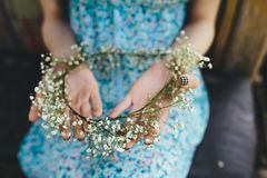 Girl holds head wreath in hands Royalty Free Stock Images