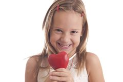 girl holds heart and smiles Stock Photo