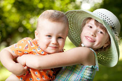 Girl holds in her arms her brother Stock Photography