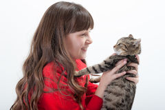 Girl holds her cat Stock Photos