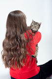 Girl holds her cat Stock Image