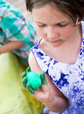Girl Holds Her Dyed Green Easter Egg Stock Photo