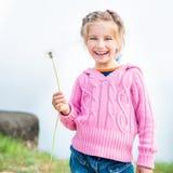 Girl holds in her hand dandelion Stock Image