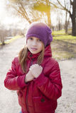 Girl holds her hands together Stock Images