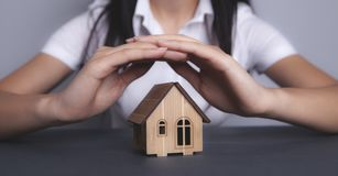 Girl holds house stock photos