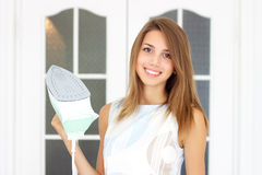Girl holds iron royalty free stock photo