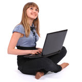 The girl holds laptop pensively looks upwards Stock Photos