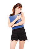 Girl holds large blue folder isolated. Girl in black holds large blue folder isolated on white background royalty free stock photo