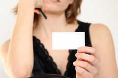 The girl holds a leaf. The girl holds a white leaf of a paper in a hand Stock Images