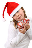 Girl holds little presents in Santa hat isolated Stock Photography