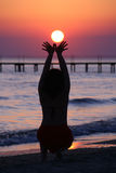 Girl Holds Lowing Sun. Stock Photography