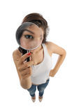 Girl holds magnify glass Stock Photography