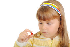 The girl holds a medicinal capsule in a hand Royalty Free Stock Photography