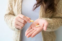 The girl holds the medicine in hand. Medical and health concepts stock photography