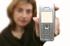 The girl holds a mobile phone Stock Photo