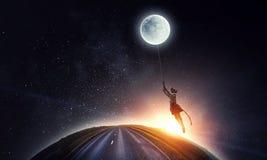 Girl holds the moon . Mixed media royalty free stock photo
