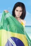 Girl holds national flag of Brazil Stock Images
