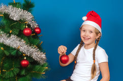The girl holds a New Year's toy in hand and smiles Stock Images